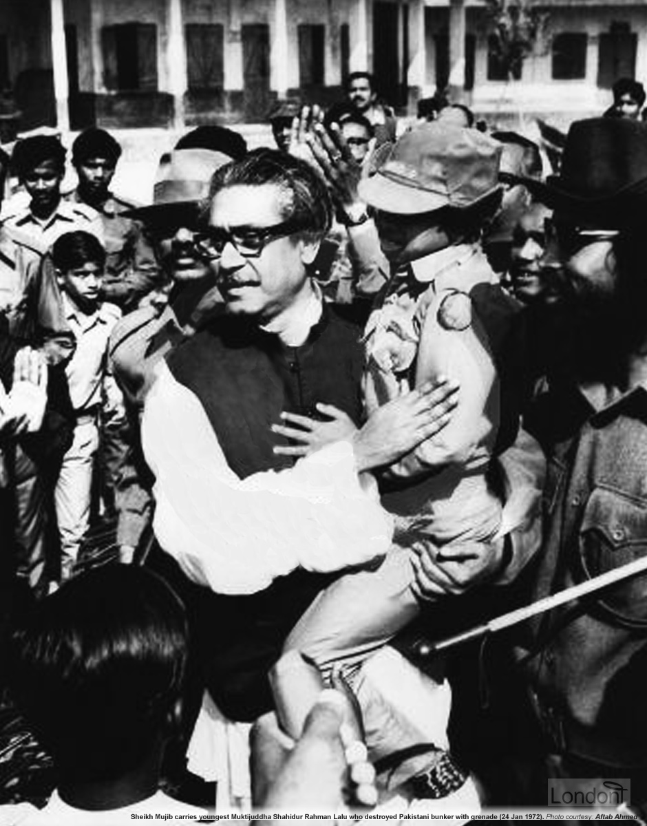 Sheikh Mujibur Rahman carrying youngest Bir Protik Shahidur Rahman Lalu who destroyed Pakistani bunker with grenade, 24 January 1972